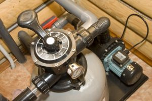 How to Clean a Sand Filter With Muriatic Acid
